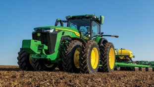 John Deere introduces the 8RX Tractor, the industry's first fixed-frame four-track tractor